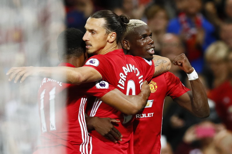 """Football Soccer Britain - Manchester United v Southampton - Premier League - Old Trafford - 19/8/16 Manchester United's Zlatan Ibrahimovic celebrates with Paul Pogba after scoring their second goal Action Images via Reuters / Jason Cairnduff Livepic EDITORIAL USE ONLY. No use with unauthorized audio, video, data, fixture lists, club/league logos or """"live"""" services. Online in-match use limited to 45 images, no video emulation. No use in betting, games or single club/league/player publications.  Please contact your account representative for further details."""